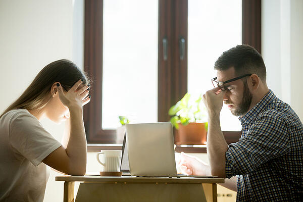 2 Frustrated Difficult coworkers at desk