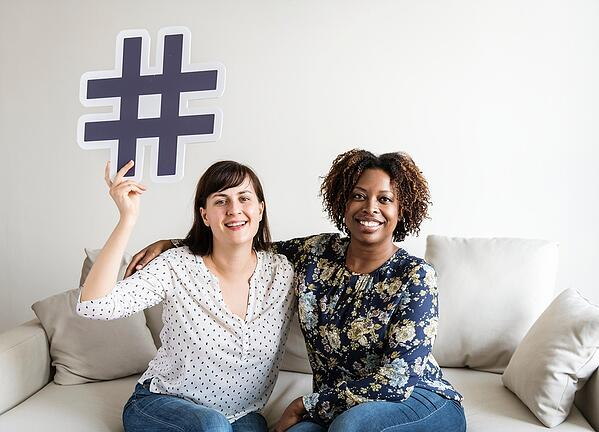 BS 2 women friends with social media hashtag icon