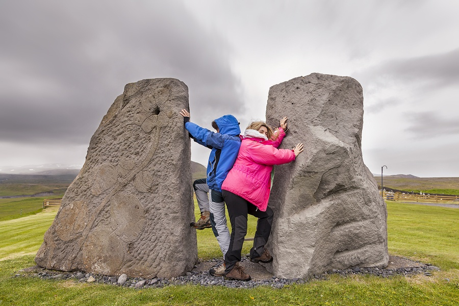 2 Female-Travelers-Having-Fun between rocks