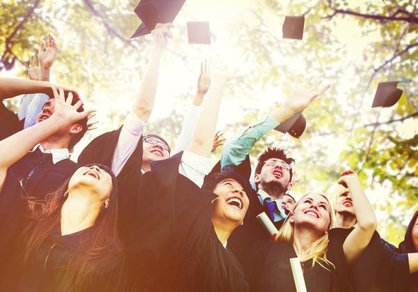 Graduates throwing up caps