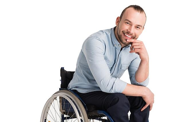 Smiling Professional Caucasian Man in wheelchair