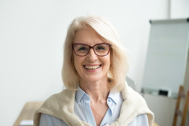 Smiling Professional Older women with glasses