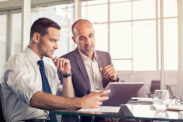 BS-Businessmen Using tablet at table.jpg