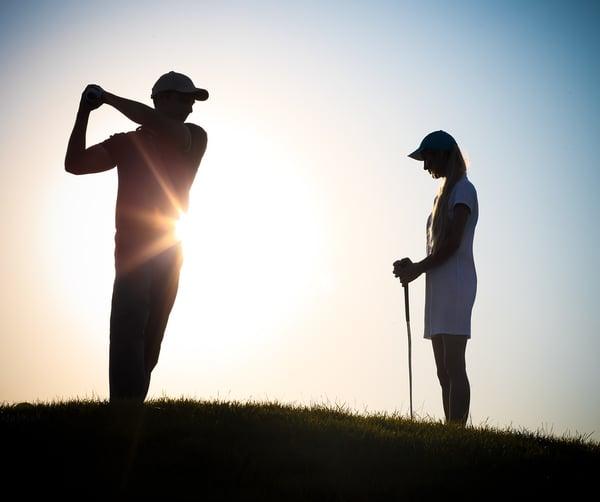 Male-And-Female Golfers