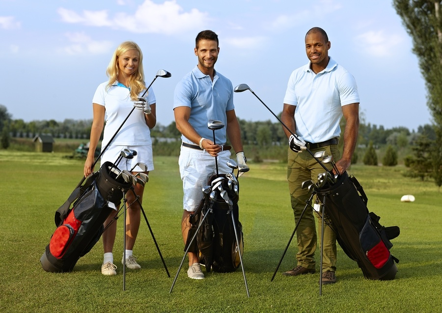 three-golfers with their golf bags