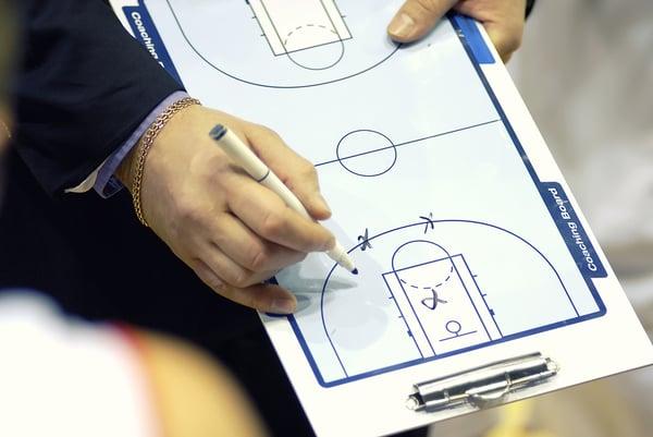Basketball-Coach-Write-Tactics-clipboard