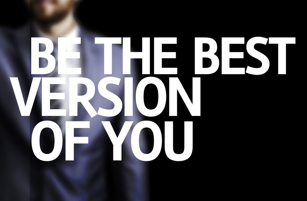 Be The Best Version Of You written on a board with a business man on background