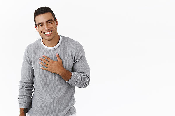 Happy-And-grateful hispanic man with hand on chest