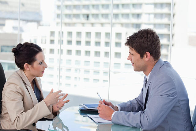 Business pair negotiating in own DISC communication style