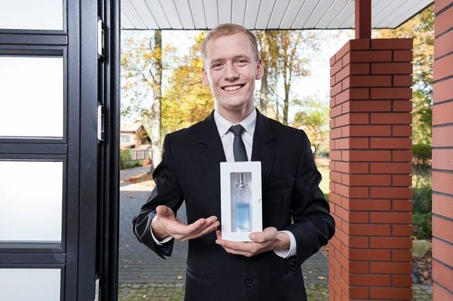 Door to door salesman selling perfume
