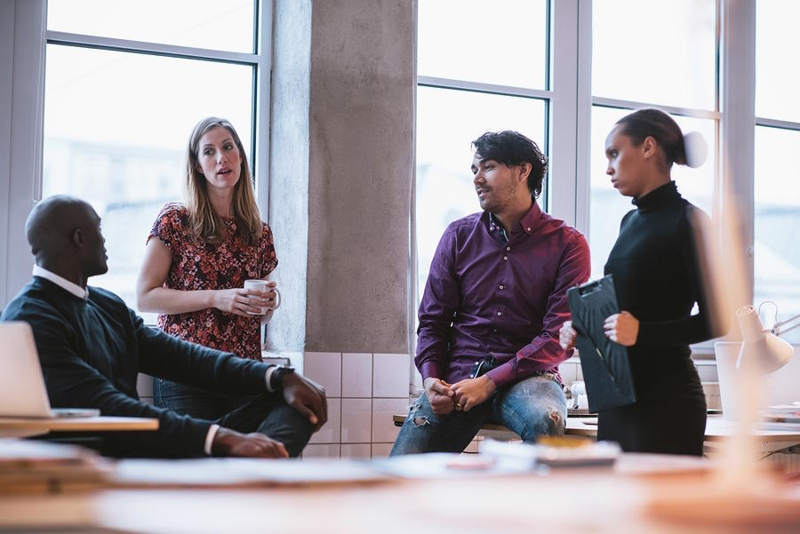 Diverse business team not communicating effectively