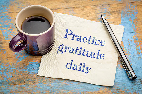 Practice-gratitude-daily-reminder cup and napkin