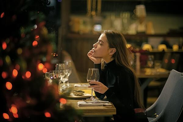 Solitary woman at party table