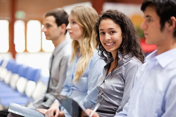Businesswoman smiling at the camera during a presentation