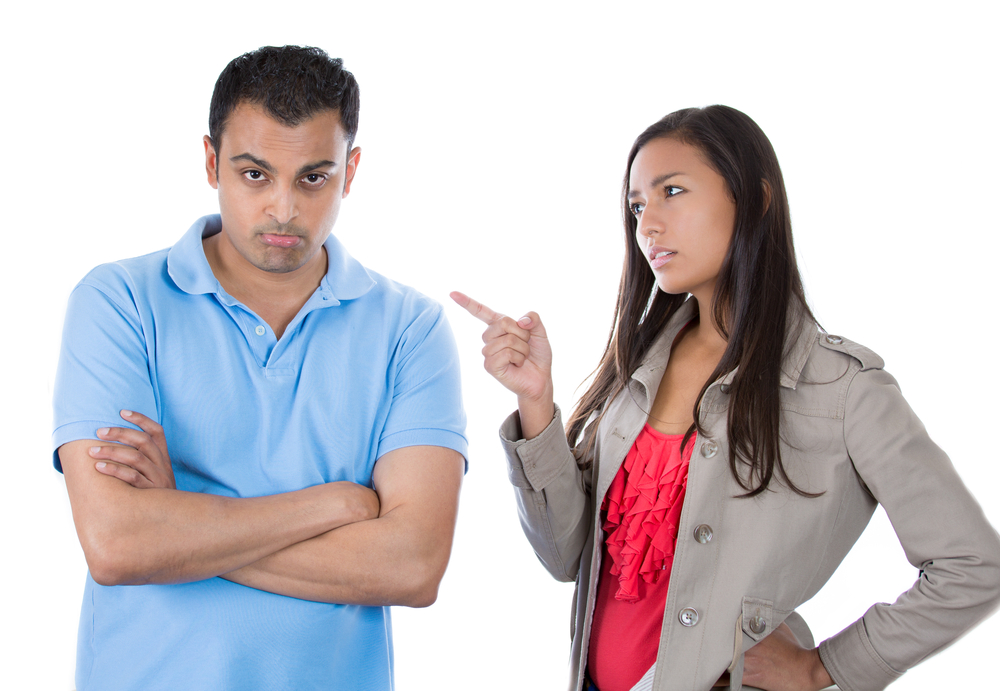 Closeup portrait of woman pointing at man as if to say bad boy because he did something wrong, isolated on white background