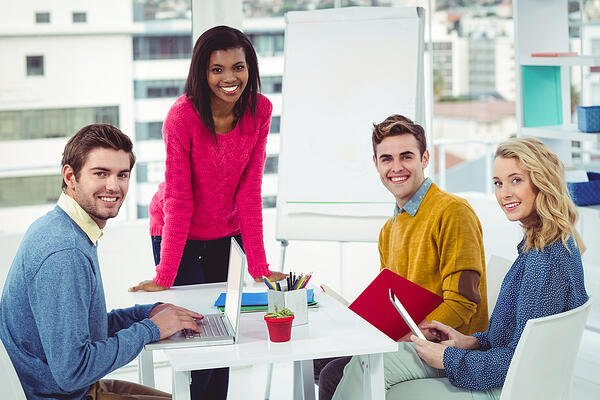 training team working together in casual office