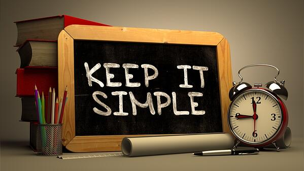 Hand Drawn Keep It Simple Concept  on Chalkboard. Blurred Background. Toned Image.