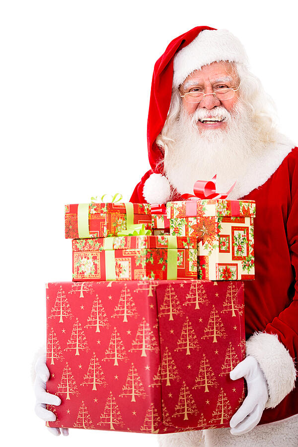 Happy Santa with Christmas gifts - isolated over a white background
