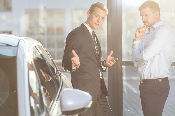 Image of car dealer offering expensive vehicle