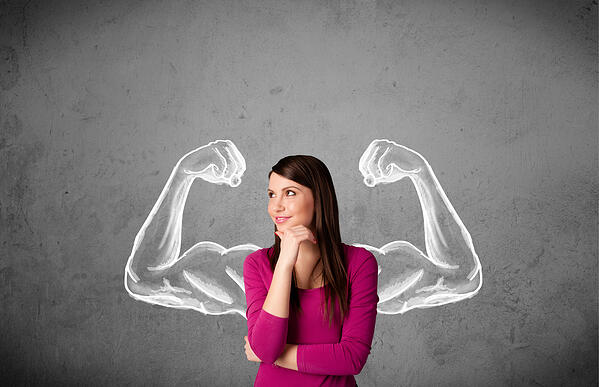 Woman with chalk muscles background showing her strenght