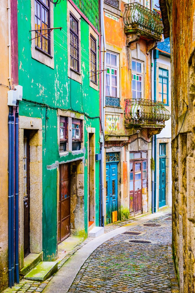 Quaint neighborhood alleyway in Porto, Portugal.