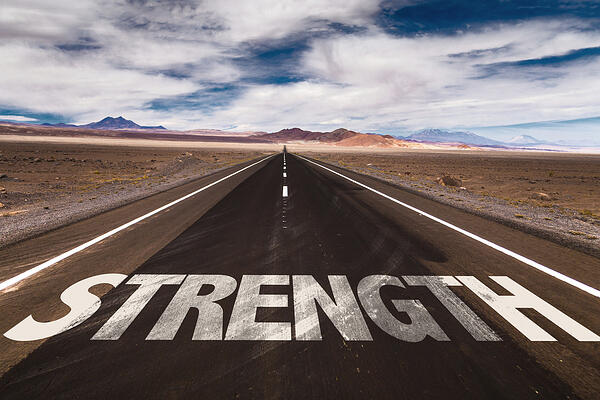 Strength written on desert road