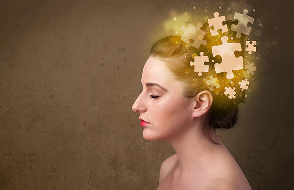 Young person thinking with glowing puzzle mind on grungy background-1