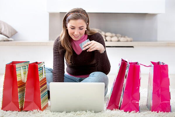happy woman portrait shopping online with bags at home