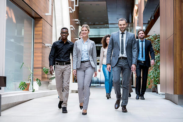young diverse business leaders walking