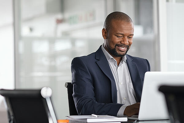 mature-african american businessman-working on computer