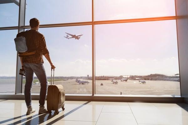 bigstock-man watching airplane with suitcase traveler