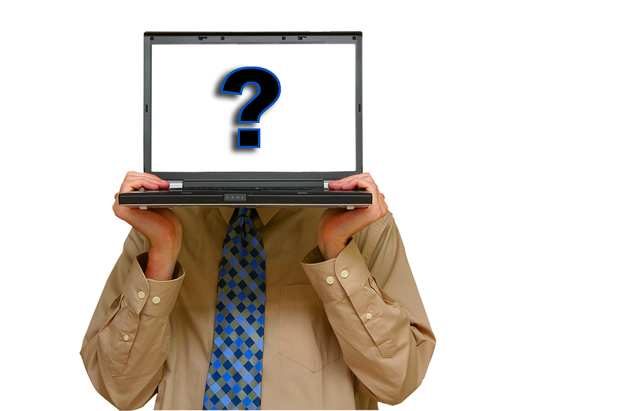 Question mark on computer screen held by male worker