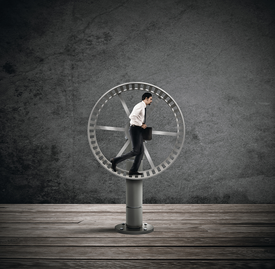 Success trap man on hamster wheel